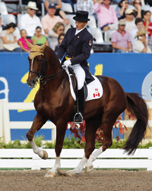 Tom Dvorak rides Viva's Salieri to Team Siver Medal in Dressage